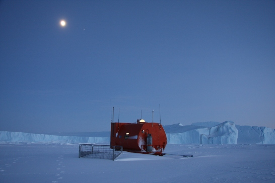 Home away from home. Combining as laboratory, workshop, kitchen and refuge, this decades-old RMIT van designed for Antarctic field work is a stalwart. At Auster Rookery it is anchored to the sea ice to withstand katabatic winds. ©Robyn Mundy